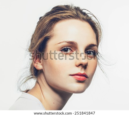 Close-up, beauty portrait of a brunette girl with beautiful lips  - stock photo