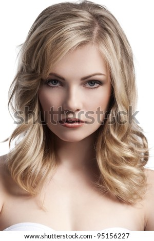 close up beauty portrait of a young and cute blond girl with hair style over white - stock photo