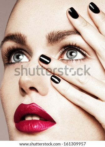 Close-up beauty portrait of beautiful model with bright make-up and manicure.  - stock photo