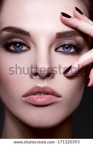 Close-up beauty portrait of beautiful model with bright make-up and manicure - stock photo