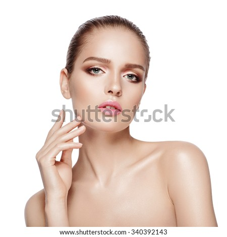Close up beauty portrait of young model with bright professional makeup. Isolated background. - stock photo