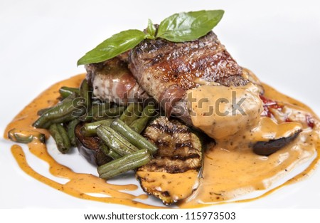 Close-up - beef steak grilled with asparagus and grilled vegetables with sauce - isolated - stock photo
