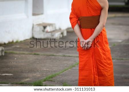 Close up behind back of a monk in temple , Luang Prabang , Laos - stock photo