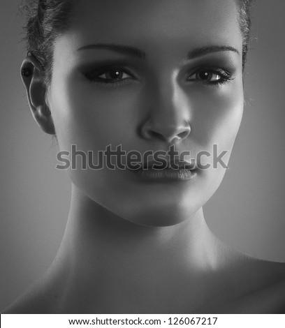 Close-up black and white portrait of beautiful stylish girl - stock photo