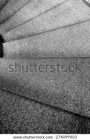 close up black and white spiral staircase - stock photo