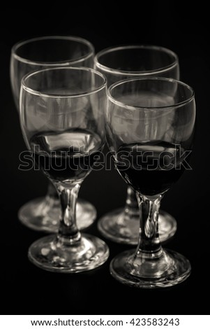 close up black cocktail into glass on black background - stock photo
