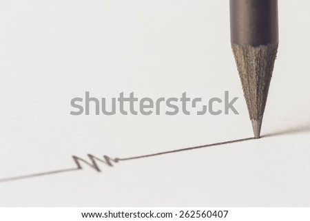 Close up Black pencil with stroke on white paper - stock photo