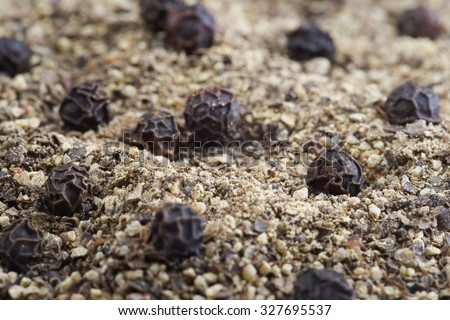 Close up black peppercorns and ground pepper - stock photo
