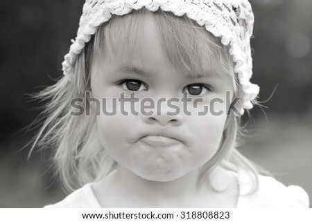 Close up black-white portrait of little girl outdoor - stock photo