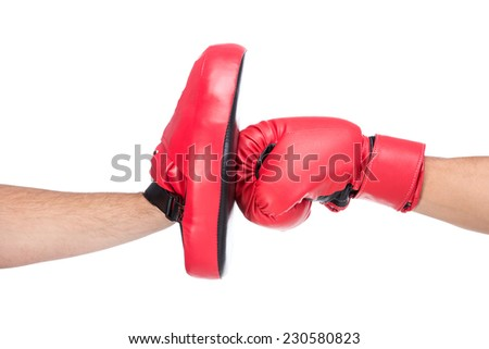 Close-up blow of a male boxer in boxing gloves. - stock photo
