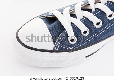 Close up blue trendy sport shoe on white background - stock photo