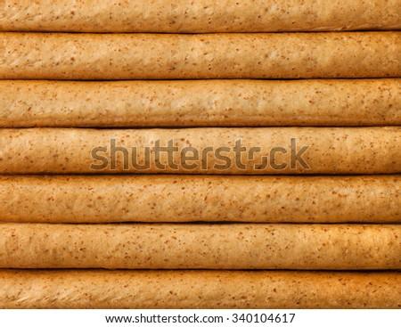 Close up Breadsticks grissini background , full frame - stock photo