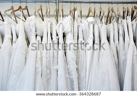 close up bride dress hanging on shelf - stock photo