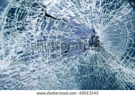Close-up broken car windshield. Tint blue - stock photo