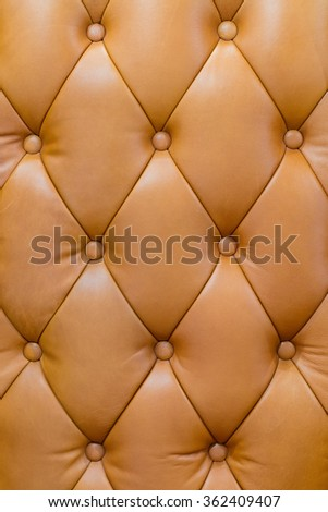 Close up brown color leather buttoned armchair back texture background - stock photo