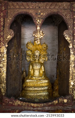 close up Buddha statue gilded in the measure - stock photo