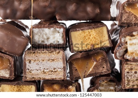 Close-up bunch of chocolate bars isolated over the white background - stock photo