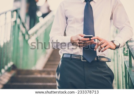 close up businessman man hands using smart phone in the city - stock photo