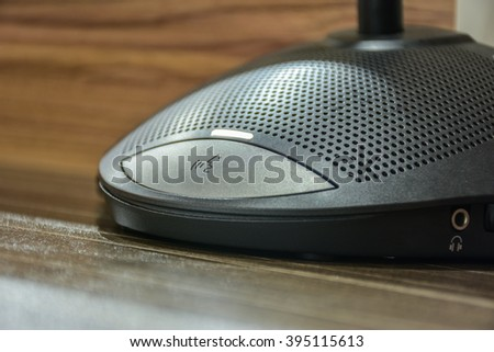 close up button on conference speaker - stock photo