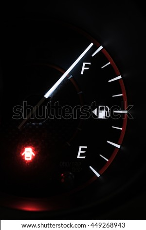 Close-up car dash board petrol meter, fuel gauge, on black background with over full gasoline in car or vehicle with red light of door open warning sign on . - stock photo