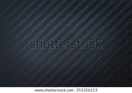 Close up carbon kevlar background pattern - stock photo