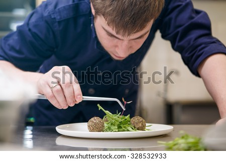 Close up chef preparing food in kitchen - stock photo