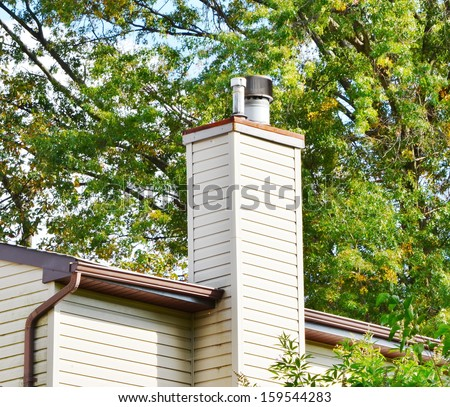 Close up chimney on the roof - stock photo