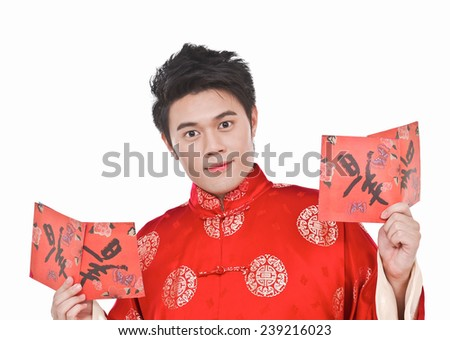 Close up chinese young man with tradition clothing holding lucky Symbol - stock photo
