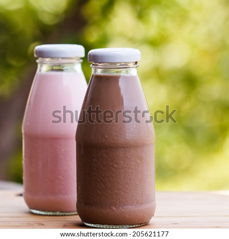 close up chocolate  milk in glass bottle - stock photo
