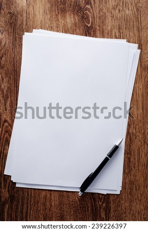 Close up Clean Bond Papers and Pen, with Copy Space for Texts, on Top of Brown Wooden Table. - stock photo