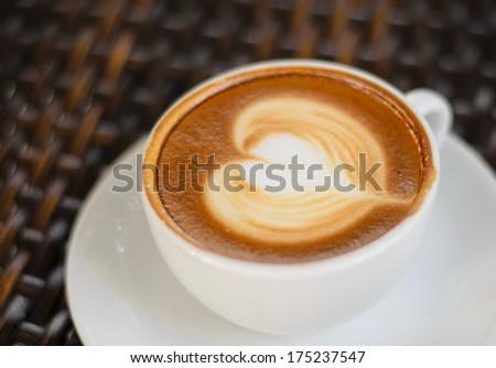 Close up Coffee latte art on black background - stock photo