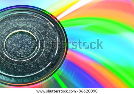 Close up color spectrum on CD reflecting by light - stock photo