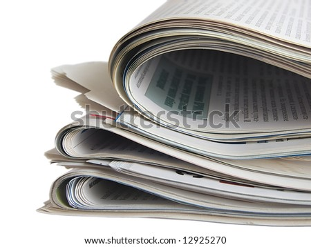 Close up colored newspapers lists isolated on white - stock photo