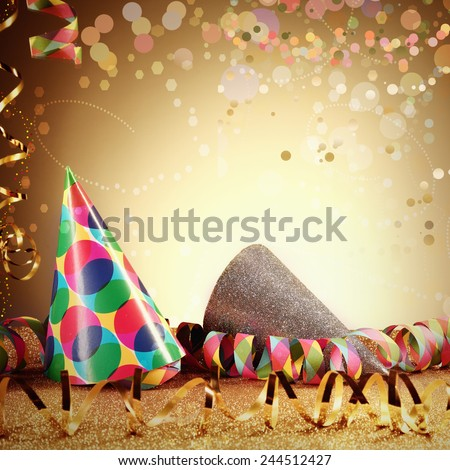 Close up Colorful Carnival Party Hats and Party Streamers on Glittery Table in front Gradient Brown Background. Emphasizing Copy Space. - stock photo