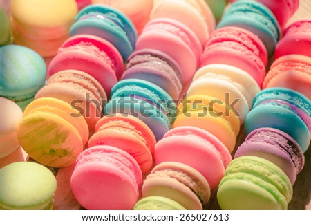 Close up colorful macarons dessert with vintage pastel tones - stock photo