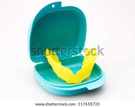 Close up colorful mouth guard isolated on white background - stock photo