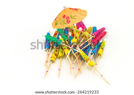 Close up colorful of many  cocktail umbrellas on white  background - stock photo