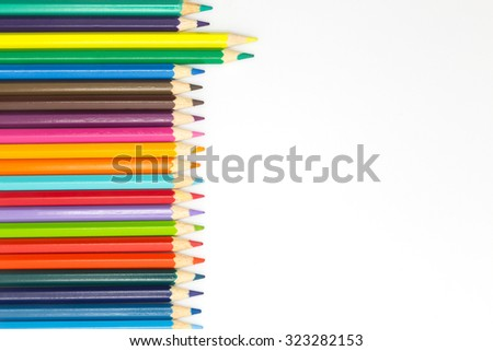 Close up colours pencils on white background - stock photo