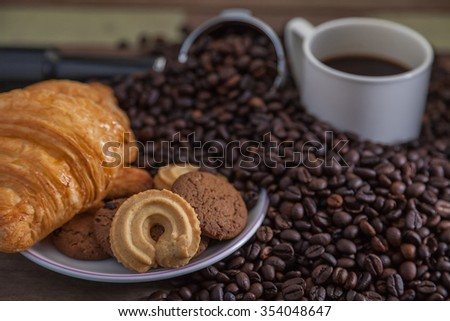 Close up cookies with coffee cup and beans - stock photo