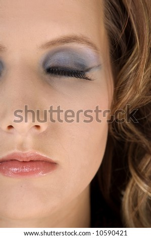 Close up cosmetic portrait of a beautiful  young woman - stock photo