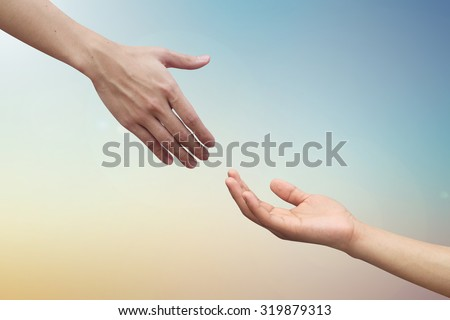 close up couple helping praying hand on blurred colorful heaven sky background.healing concept.medical faithful.compassion of human ideal conceptual.friendship and relationship of love affection. - stock photo