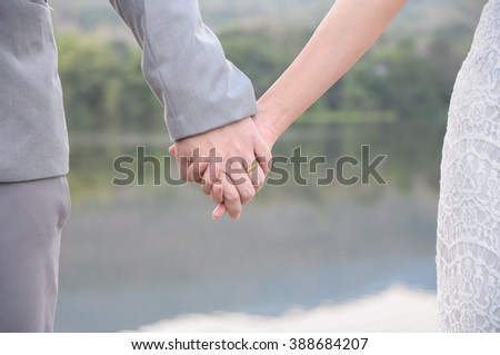 close up couple holding hand together concept of love. - stock photo