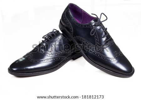 Close up couple mans shoes on the white background - stock photo