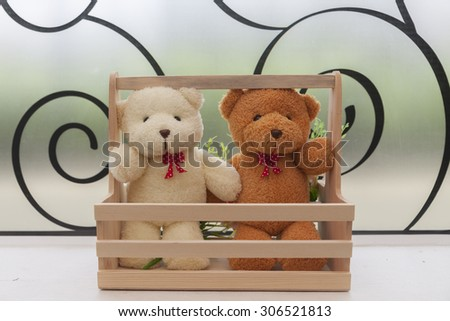 Close up - Couple teddy bears in wood basket. - stock photo