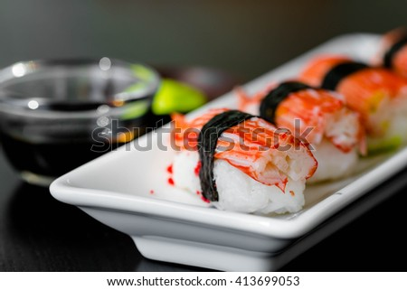 close up crab sticks sushi in white plate - stock photo