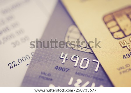 Close up credit card, with retro filter effect - stock photo