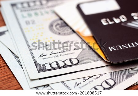 Close-up credit cards on dollars notes with shallow depth of field - stock photo