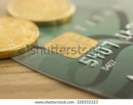 close-up credit cards with golden coins. selective focus. finance and banking concept. - stock photo
