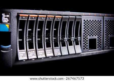 Close up curved hard disk on computer server - stock photo