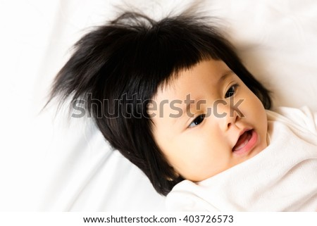Close up cute happy smiling Asian baby, 5 months after birth. - stock photo